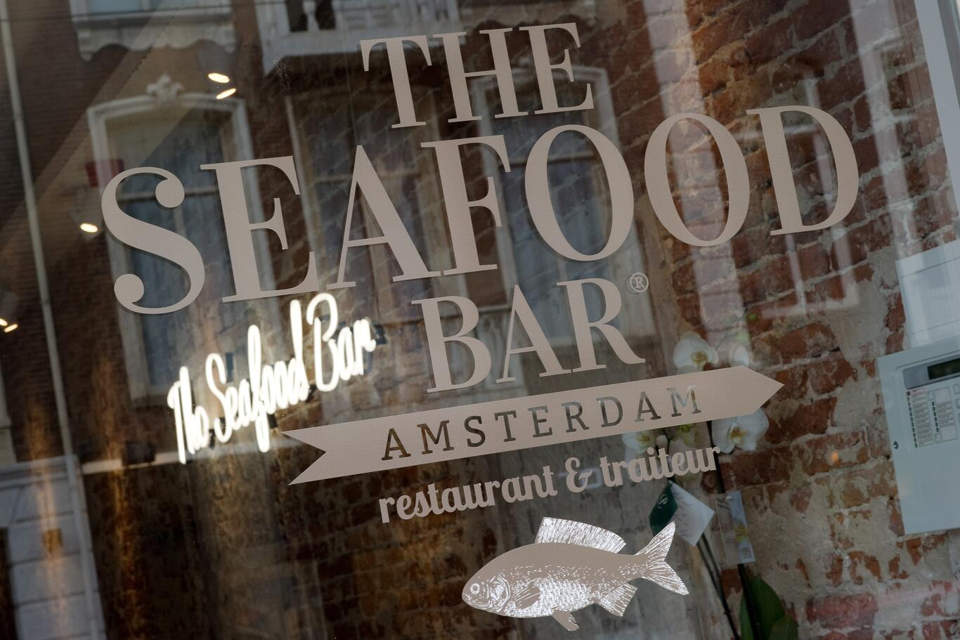 Photography of the logo on the facade of seafood bar, Amsterdam